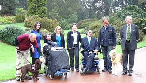 Photo of people and assistance dogs at 2016 launch event at Royal Botanic Garden Edinburgh