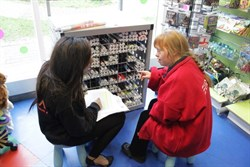 Photograph of Natalie a volunteer on the volunteerability programme in a shop