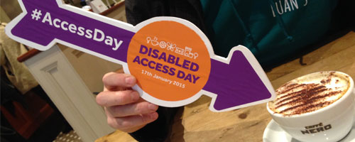 Photograph of a cup of coffee at Caffè Nero with a 'Disabled Access Day' arrow