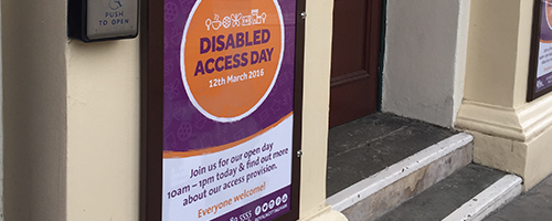 Photograph of Disabled Access Day signage outside of the theatre